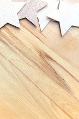 Wooden carved stars on wooden background.