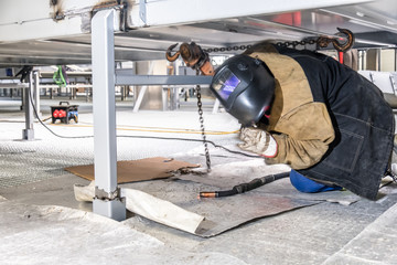 Metal construction worker with blurred motion