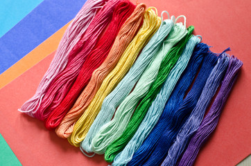 Embroidery floss on a colored background