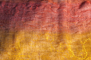 The texture of wool fabric yellow red golden