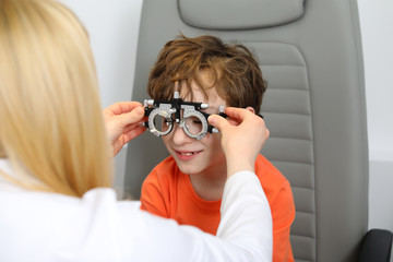 eye examination, Optometrist in exam room with young boy