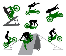 Stunt show on a motorcycle and snowmobile. Silhouette of stunt man.