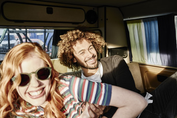Happy young couple in a van