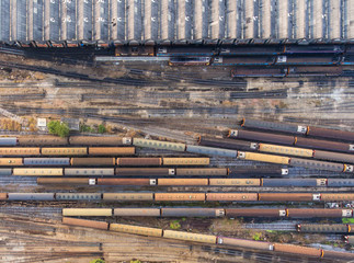 Freight and passenger train waiting at the train station parking lot.Cargo transit.import export and business logistic.Aerial view.Top view.