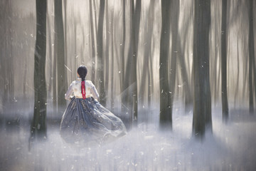 Korean Girl dressed in traditional dress in the winter magic forest