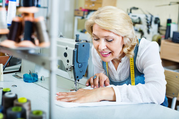 Female tailor working on sewing machine