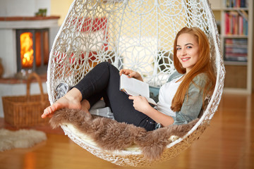 Young girl relaxing with a book at home