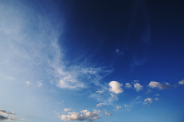 Blue sky with white clouds. Blue natural background