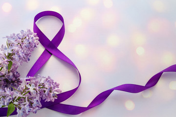 International Women's Day. 8 March. Greeting Card. Decoration with Purple Ribbon and Lilac on a white background with bokeh.