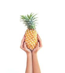 A pineapple.Pipe Pineapple in hand studio white background. Fruit Pineapple. Arms. Asia.