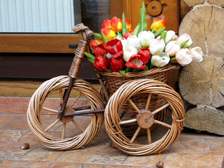 Hand made braided toy bicycle floral composition photo