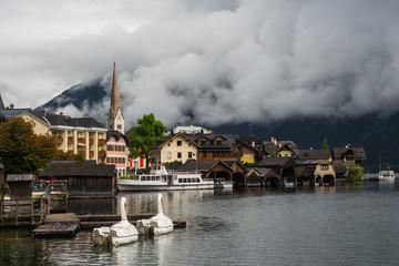 Old touristic Hallstatt in the clouds, Austria.