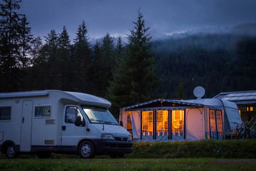 Campervan and awning in austrian camping at night