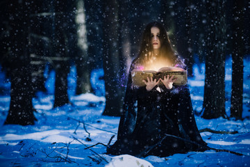Sorceress celebrating the magic of the magic books