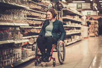 Disabled woman in a wheelchair in a department store