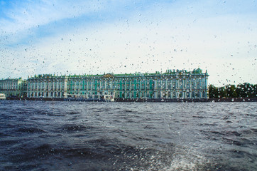 Drops of rain on glass, view from the boat on the Hermitage Museum St. Petersburg Russia