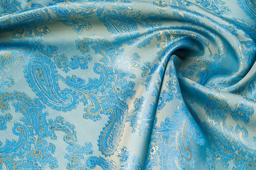Fabric silk texture, background. Blue patterned