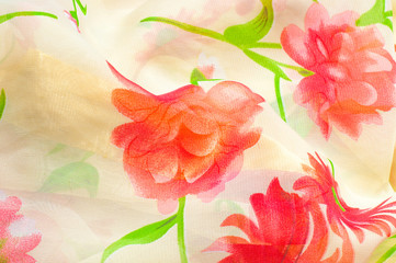 texture of silk fabric. background. Beige with red flowers