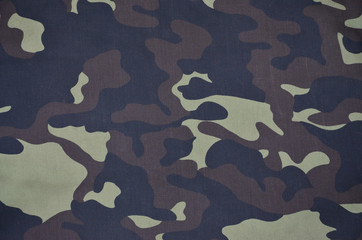 Texture of fabric with a camouflage painted in colors of the marsh. Army background image. Textile pattern of military camouflage fabric