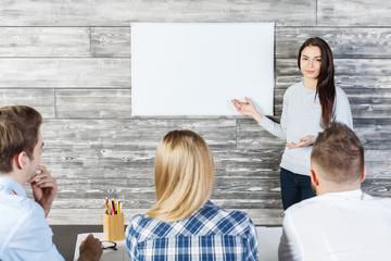 Pretty woman showing whiteboard