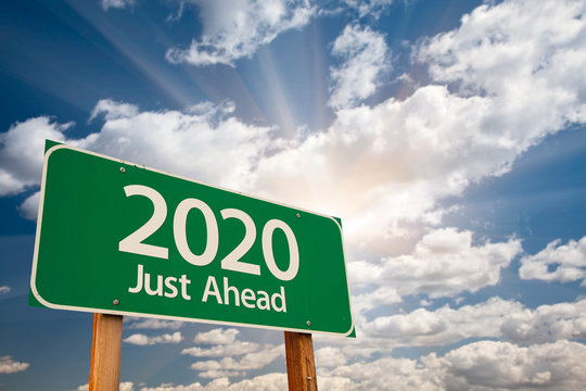 2020 Green Road Sign Over Dramatic Clouds and Sky.