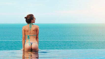 Beautiful woman in an infinity pool