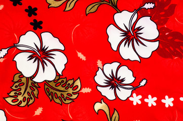Cotton fabric texture, background, painted white flowers on a red background.