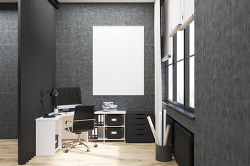 Gray walled office with poster