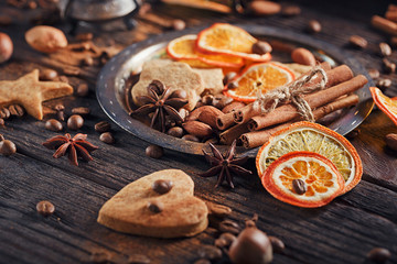 Homemade gingerbread cookies, spices and decorations