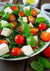 Vegetarian salad with cherry tomato, mozzarella and rucola