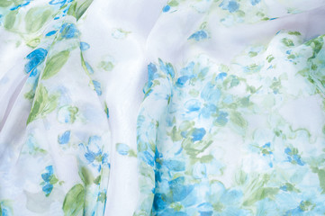 Silk fabric texture, background, painted white with blue flowers