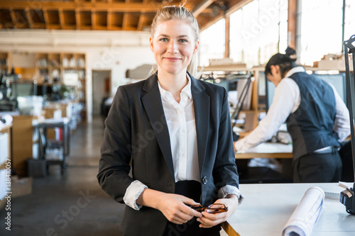 """Casual lifestyle portrait of experienced female staff ..."