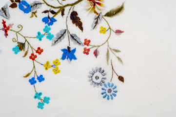 texture, background, fabric cotton white. With flowers stylized embroidery