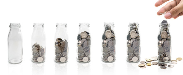 Saving money concept of collecting coins in glass bottle Isolated on white background. copy space.