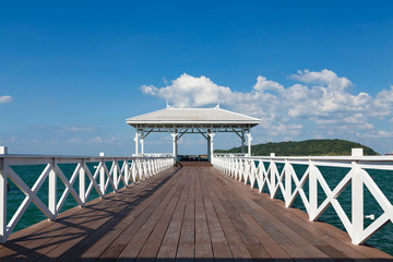 White wooden walkway leading to seacoast skyline, natural landscape background