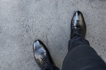 Top view of businessman legs wearing black shoes walking go to dream