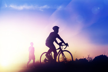 Ride bicycle at sunset