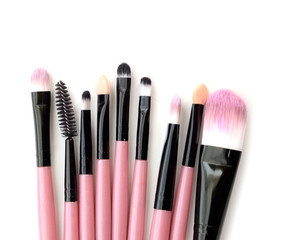 Various makeup brushes isolated over white background