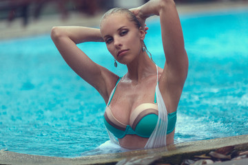seductively woman posing in a pool
