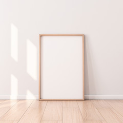 Poster with Wooden Frame Mockup standing on the floor. 3d rendering