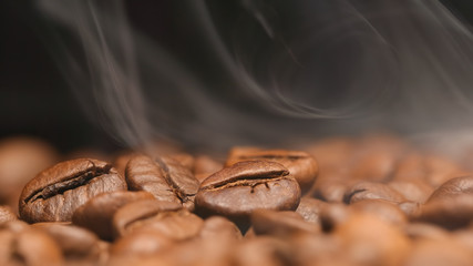 Fotobehang Koffiebonen MACRO: Smoke over a roasted coffee beans