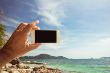 Take a photo of the landscape of water on the phone. Blank screen smart phone.
