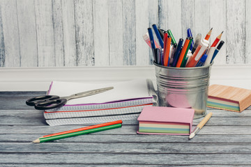 stationery in an iron stand, sheets of paper, notebook