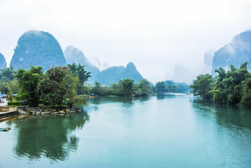 Karst mountains and river scenery in the mist
