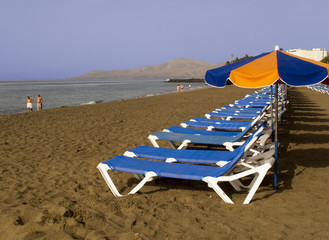 Sunbeds on beach at Puerto Del Carmen Lanzarote