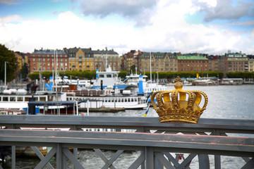 Skeppsholmsbron (Skeppsholm Bridge) with Golden Crown on a bridge in Stockholm, Sweden