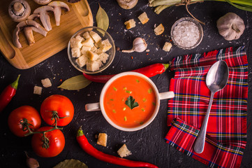 tomato soup on a dark background