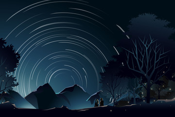 couple watch star trail in forest