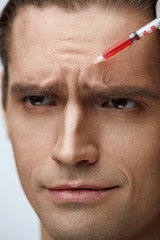 Portrait Of Handsome Male Getting Facial Beauty Injections