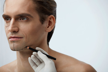 Facial Beauty Operation. Handsome Man With Lines On Face